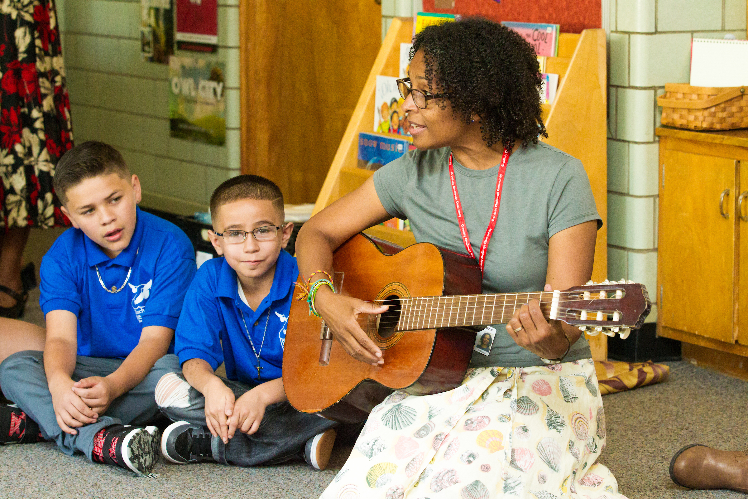 Beach Court music teacher plays guitar for students