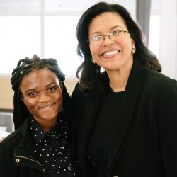 DPS student Lumiere Sidonie poses with Colorado Department of Higher Education Executive Director Dr. Kim Hunter Reed