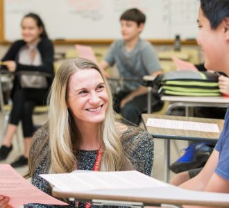 Merrill Middle School counselor talks with a student